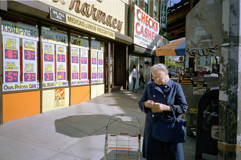 Mom in front of the Kraupner Pharmacy on the northeast corner of Greene Avenue and Knickerbocker Avenue.  The store fronts Knickerbocker.