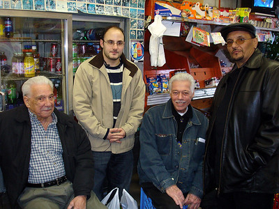 Some of the boys hanging at the store for warmth and company on a winter's night.  Left to right: Armando, Anthony, Pedro, Louis.  Pedro has a degree from a local college and is a man of uncommon business integrity.