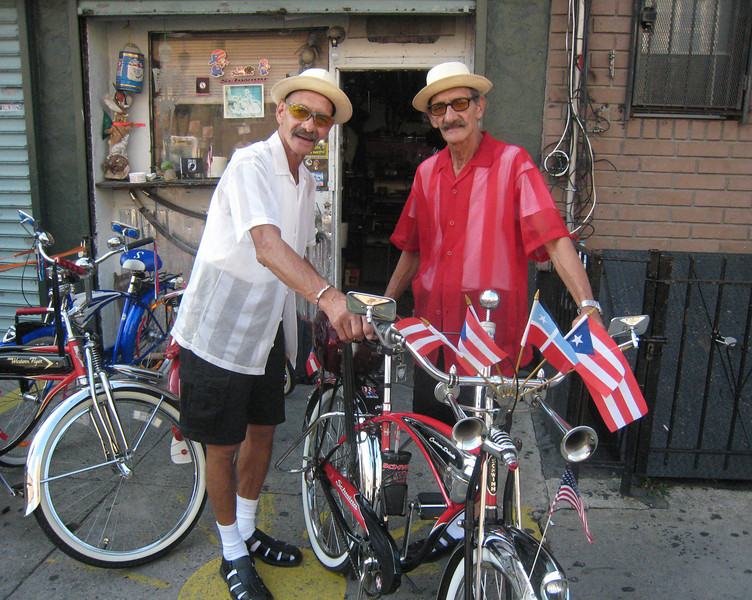 The Estrada twins are members of the Puerto Rican Bicycle Club.  The Club assembles forays to far-flung destinations in New York City.  The twins' names are Wilfredo and Roberto, but I don't know which is which.