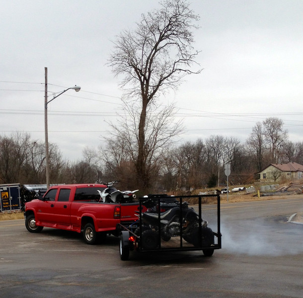 Brian loaded with 2 quads and a Harley, headed to Florida.
