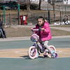 """The playground equipment at Joanne """"Mama"""" Fitz Memorial Playground in Fitchburg was still off limits to play on during the coronavirus emergency Thursday, March 26, 2020. That did not stop Danielle Moriarty from bring her son Dillon, 8, and her granddaughter Taytum Emery, 4 pictured, to the park to ride their bikes on the basketball court to get them out of the house. SENTINEL & ENTERPRISE/JOHN LOVE"""