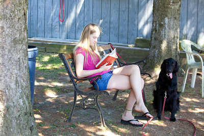 Annie reads a book while Anisa rides.
