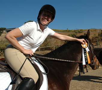 Jen showing off one of her ribbon after placing in her Hunters Class (and Reco not caring)