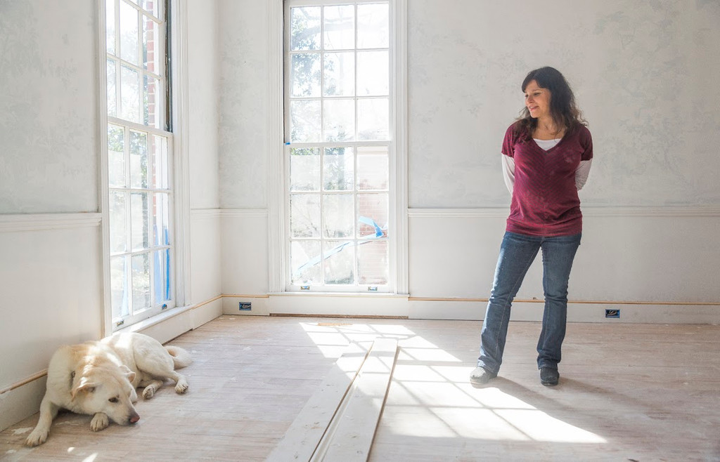 Andi Biron with her dog Houdini in the Macon house she and her husband are renovating for their home and as the hub of her tea business Biron Herbal Teas.