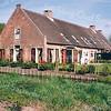 RM015   Rijksstraatweg 71 - boerderij 'Wiltrijk'<br /> <br /> Dit is de achterkant van boerderij Wiltrijk aan de Hoofdstraat 55. de achterzijde keek vroeger over de weilanden richting Voorhout uit. Nu plan Postwijk.  De voordeur zat oorspronkelijk aan de voorzijde, en keek uit naar de Hoofdstraat. Deze boerderij, die uit 1645 dateert, is recentelijk gerestaureerd en is van het type langhuisboerderij. Dat wil zeggen: het woongedeelte ligt vooraan en de bedrijfsruimten zijn er meteen aangebouwd zonder een apart overgangsgedeelte. De voordeur met het hoge bovenlicht ligt in het midden van de voorpui. <br /> <br /> <br /> Meer informatie is te vinden in 'Monumenten in Sassenheim', een uitgave van de Stichting Oud Sassenheim.