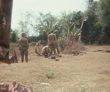 AR-9 Company A takes a break on the trail. That might be Sgt. Finnis McCleery on the left.