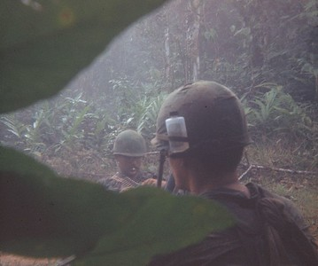 AR-13 John 'Chunky' Carlson (NJ), left, and a grunt with bug repellant on in his helmet band
