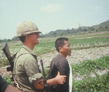 AR-3 Sgt. John Hacker (CA), leads a POW