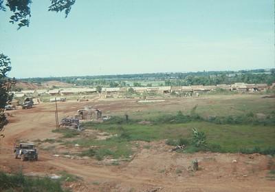 AR-23 A photo of basecamp, a truck, bulldozer, bunker, and barracks