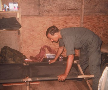 AR-15 Tony Cordia straightens his cot in basecamp barracks