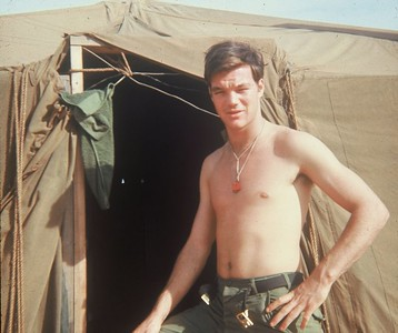 AR-20 Larry Boetsch (NJ), with his dogtags fixed so they won't make noise, in front of a tent in basecamp