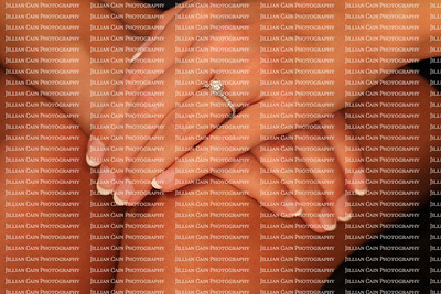 Beautiful hands modeling a solitaire diamond engagement ring
