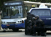"Police keep watch of a hijacked bus in Rio de Janeiro, Brazil, June 12, 2000. The bus, with 6 passengers aboard, was hijacked by Sandro do Nascimento for about 4 hours after a robbery went wrong. When he agreed to surrender, police officers attempted to shoot him but ended up killing one of the passengers. The incident, broadcast on live TV in Brazil, demonstrated the incompetence of Rio's police and shocked cariocas (Rio residents), normally accustomed to such things. The event was also immortalized by the Jose Padilha film ""Onibus 174"" (Bus 174). (Australfoto/Douglas Engle)"