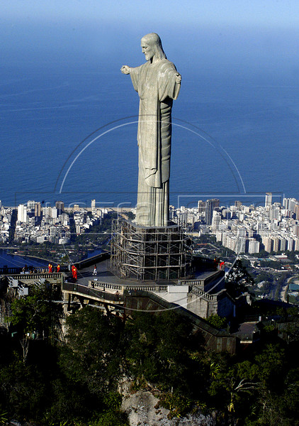 "View of the Christ the Redeemer in Rio de Janeiro selected in Portugal as one of the new seven wonders of the world in a global poll announced, July 7, 2007, together with China's Great Wall, Jordan's Petra, Peru's Machu Picchu, Mexico's Chichen Itza pyramid, Rome's Colosseum and India's Taj Mahal. Nearly 100 million Internet and phone voters chose these sites as the seven ""new"" wonders of the world 08 July 2007. This photo was taken in June 6, 2005 during a commemoration of the World Environment Day by World Wildlife Foundation (WWF) in the Corcovado mountain.  (Australfoto/Renzo Gostoli)"