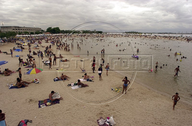 "Beach-goers enjoy the sand at the artificial pool in the Ramos neighborhood in Rio de Janeiro. The pool, known as ""piscin‹o"" brought the Ramos beach on the polluted Guanabara Bay back to life. (Australfoto/Douglas Engle)"