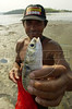 A fishermen shows off a fish caught in the Guanabara Bay in Rio de Janeiro.(Australfoto/Douglas Engle)