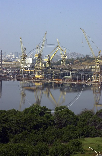 Cranes of the port of Rio rise above the mangroves on the Guanbara Bay in Rio de Janeiro. (Australfoto/Douglas Engle)