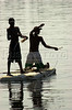 Boys fish from a piece of styrofoam in the Guanabara Bay in Rio de Janeiro.(Australfoto/Douglas Engle)
