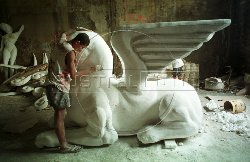 Luiz Paulo Zamora works on a statue, which will be used on an allegorical carnival float, at the Salgueiro Samba School workshop in Rio de Janeiro, Brazil. (Douglas Engle/Australfoto)