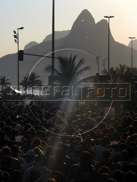 Costumed revelers celebrate carnival in one or Rio de Janeiro's many street parades on Ipanema Beach. (Douglas Engle/Australfoto)