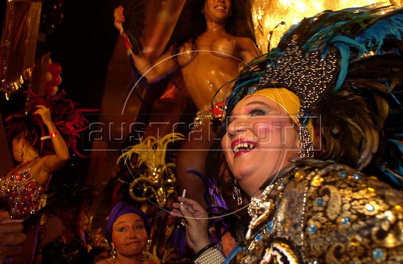 Revelers enjoy an annual gay ball during carnival in Rio de Janeiro, Brazil, early Thursday February 28, 2001. (Australfoto/Douglas Engle)