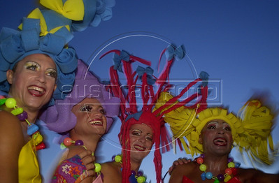 Disguised revelers pose during a pre-carnaval street parade in Rio de Janeiro, Sunday, February, 18, 2001. Carnaval in Rio is from February 23-26.(Australfoto/Douglas Engle)