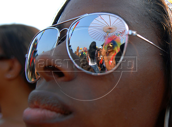 A follower reflects on sunglaces of a participant during the XII Gay Parade at the Copacabana beach in Rio de Janeiro, Brazil, Oct. 14, 2007.  Gays, lesbians, and transexuals asks for opportunities, equality, respect, and this year as well for punishement for those who discriminate the homosexuals. (Austral Foto/Renzo Gostoli)