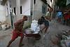 Workers take construction materials up the Mangueira Botafogo slum in Rio de Janeiro, Brazil. (Australfoto/Douglas Engle)