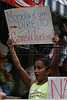 """A girl holds sign reading """"Housing is a constitutional right"""" during a protest against the possible removal of several slums in the Parque da Cidade slum in Rio de Janeiro, Brazil, Oct. 27, 2005.(Australfoto/Douglas Engle)"""