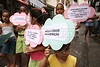 Girls holds signs during a protest against the possible removal of several slums in the Parque da Cidade slum in Rio de Janeiro, Brazil, Oct. 27, 2005.(Australfoto/Douglas Engle)