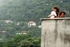Residents of the Parque da Cidade slum overlook posh homes in the Atlantic Rainforest of a nearby mountain in Rio de Janeiro, Brazil, Oct. 27, 2005.(Australfoto/Douglas Engle)