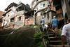 Residents walk through the Parque da Cidade slum in Rio de Janeiro, Brazil, Oct. 27, 2005.(Australfoto/Douglas Engle)