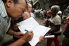 Supporters of slum residents sign a petition book during a protest against the removal of several slum in the Parque da Cidade slum in Rio de Janeiro, Brazil, Oct. 27, 2005.(Australfoto/Douglas Engle)