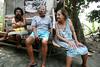 Ilka Bento Perreira holds Vitoria Roque Adriano, 2, left, and Euclides Santana da Silva, center and Gloria Roque Adriano, right, in the Vila Alice slum in Rio de Janeiro, Brazil, Oct. 26, 2005. (Foto/Douglas Engle/Australfoto)