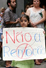 """A girl holds sign reading """"No to Removal"""" during a protest against the possible removal of several slums in the Parque da Cidade slum in Rio de Janeiro, Brazil, Oct. 27, 2005.(Australfoto/Douglas Engle)"""
