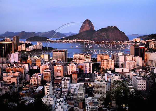 A view of the Botafogo Bay and Sugarloaf mountain glow in the evening, Rio de Janeiro, Brazil, April 23, 2011. (Austral Foto/Renzo Gostoli)