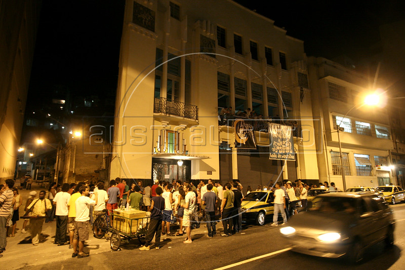 """A crowd lies the street outside the """"Castelo dos Democraticos"""" samba house in the Lapa district of Rio de Janeiro. Once a forgotten part of the city near downtown, Lapa, samba music and  show houses are experiencing a renaissance uncommmon to Brazil, which does not tend to value anything old.(Australfoto/Douglas Engle)"""