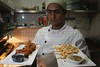 A chef displays creations at the Sawasdee Thai restaurant in the Leblon district of Rio de Janeiro, Brazil. (Australfoto/Douglas Engle)