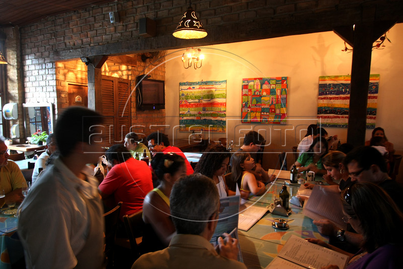 The Sobrenatural restaurant in the Santa Tereza neighborhood of Rio de Janeiro. One of the city's most charming areas, located on a hill close to downtown. It was one of the first aristocratic neighborhood and many historic homes and buildings are still there today. Largely abandoned by the elite ages ago, has been taken over by bohemians who have opened cafes, bars and galleries.  (Australfoto/Douglas Engle)