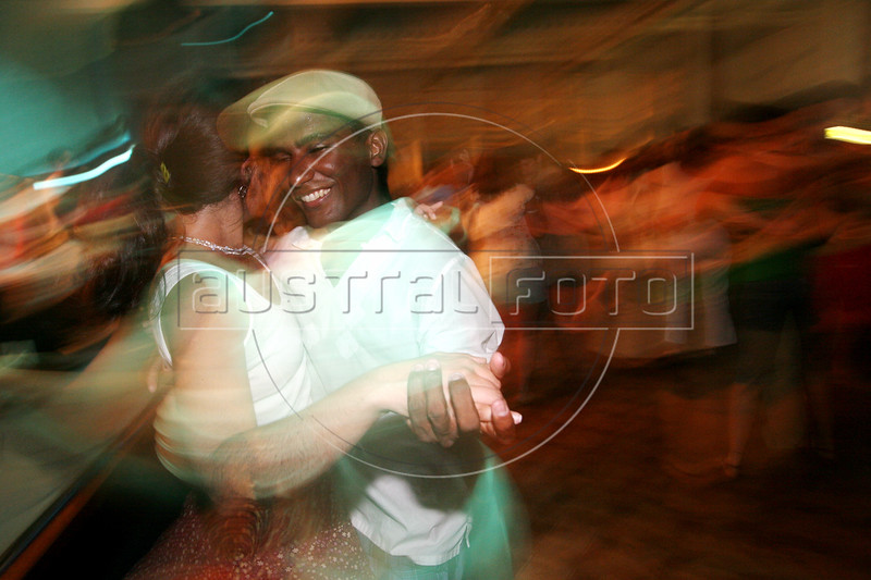 Davi Santos dances with Renata Neder, left, at a samba club in the Lapa district of Rio de Janeiro. Once a forgotten part of the city near downtown, Lapa, samba music and  show houses are experiencing a renaissance uncommmon to Brazil, which does not tend to value anything old.(Australfoto/Douglas Engle)