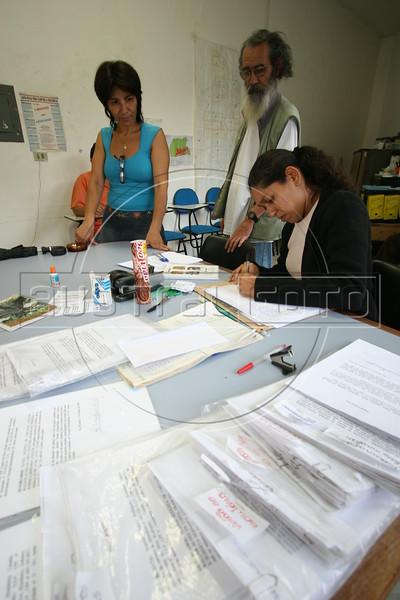 "Slum residents do paperwork to legalize their properties at the offices of ""Rocinha mais Legal,"" in the Rocinha slum in Rio de Janeiro. Australfoto/Douglas Engle)"