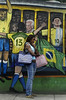 "A woman waits the tipical tramway (bonde) in front of a mural regarding the 2006 Germany Soccer World Cup in a street of Santa Tereza city district, Rio de Janeiro, Brazil, June 6, 2006. The "" bondinho"" of Santa Teresa is a historic tram line in Rio de Janeiro connecting the city centre with the primarily residential, inner-city neighbourhood of Santa Teresa, in the hills immediately southwest of downtown. In late August 2011 five people were killed and at least 27 injured when a tram derailed. All service has been indefinitely suspended since the accident. (Austral Foto/Renzo Gostoli)"
