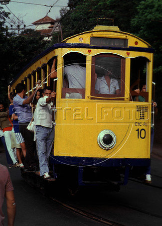 "A tipical tramway (bonde) runs alongside a street of Santa Tereza city district, Rio de Janeiro, Brazil, November 28, 1987. The "" bondinho"" of Santa Teresa is a historic tram line in Rio de Janeiro connecting the city centre with the primarily residential, inner-city neighbourhood of Santa Teresa, in the hills immediately southwest of downtown. In late August 2011 five people were killed and at least 27 injured when a tram derailed. All service has been indefinitely suspended since the accident. (Austral Foto/Renzo Gostoli)"