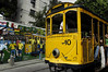 """A tipical tramway (bonde) past by a mural regarding the 2006 Germany Soccer World Cup in a street of Santa Tereza city district, Rio de Janeiro, Brazil, June 6, 2006. The """" bondinho"""" of Santa Teresa is a historic tram line in Rio de Janeiro connecting the city centre with the primarily residential, inner-city neighbourhood of Santa Teresa, in the hills immediately southwest of downtown. In late August 2011 five people were killed and at least 27 injured when a tram derailed. All service has been indefinitely suspended since the accident. (Austral Foto/Renzo Gostoli)"""