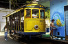 "A tipical tramway (bonde) past by a mural regarding the 2001  Soccer World Cup in a street of Santa Tereza city district, Rio de Janeiro, Brazil, June 11, 2002. The "" bondinho"" of Santa Teresa is a historic tram line in Rio de Janeiro connecting the city centre with the primarily residential, inner-city neighbourhood of Santa Teresa, in the hills immediately southwest of downtown. In late August 2011 five people were killed and at least 27 injured when a tram derailed. All service has been indefinitely suspended since the accident. (Austral Foto/Renzo Gostoli)"