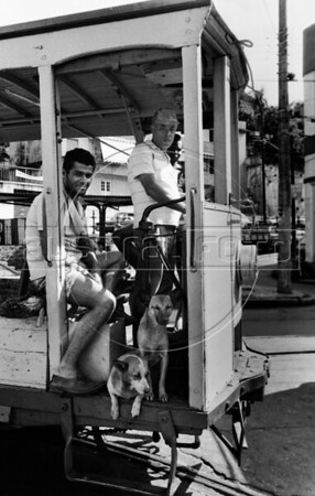 "A tramway's vehicle repair (bonde) runs alongside a street of Santa Tereza city district, Rio de Janeiro, Brazil, November 28, 1987. The "" bondinho"" of Santa Teresa is a historic tram line in Rio de Janeiro connecting the city centre with the primarily residential, inner-city neighbourhood of Santa Teresa, in the hills immediately southwest of downtown. In late August 2011 five people were killed and at least 27 injured when a tram derailed. All service has been indefinitely suspended since the accident. (Austral Foto/Renzo Gostoli)"