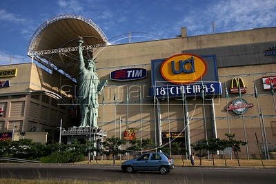 Pedestrians pass a replica of the Statue of Liberty in front of a shopping mall in the Barra da Tijuca district of Rio de Janeiro, Brazil, Jan. 24, 2006. (Australfoto/Douglas Engle)