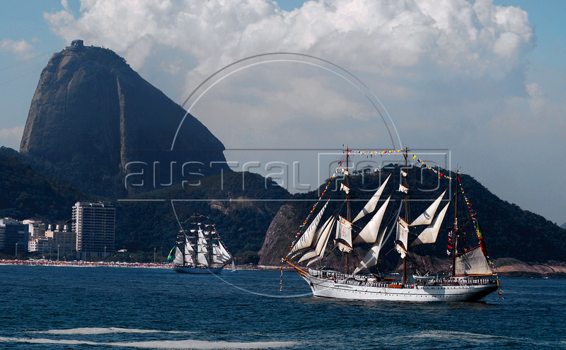 "Sailboats ""Cisne Branco"", left, of Brazilian Navy, and ""Sagres"", right, of Portuguese navy, take part in maritime parade to celebrate the Brazil's Independence day in front of Sugar Loaf, Copacabana, Rio de Janeiro, Brazil, Sep. 7, 2007.<br /> (Australfoto/Renzo Gostoli)"