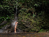 A woman takes a bath in a natural shower in the Tijuca Forest in  Rio de Janeiro.(Australfoto/Douglas Engle)