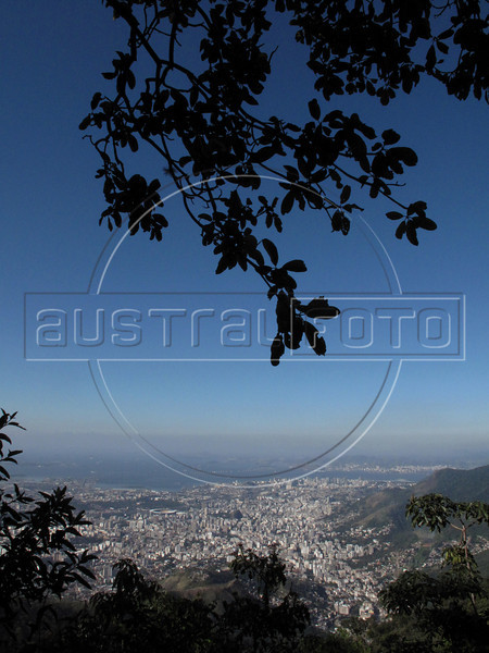 A view of Rio's north side, from the Tijuca Forest National Park in Rio de Janeiro. The park, a forested mountain surrounded by an intensely populated urban area, is a model of preservation of the Brazil's Atlantic Forest ecosystem, of which only 7% remains. It is allegedly the largest urban forest in the world, and declared a National Park in 1961.  Formerly a coffee planting area and Rio's water source, Brazilian Emperor Dom Pedro II had the area completely reforested in the 1860s as the city's water supply began to dwindle. It is home to hundreds of species of plants and wildlife, many threatened by extinction (Australfoto/Douglas Engle)